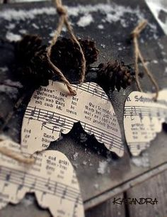 angel wing ornaments made from sheet music or old book pages. would add some glitter... of coarse!