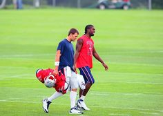Tom Brady and Randy Moss walk off the field together after a August 2008 training camp practice.