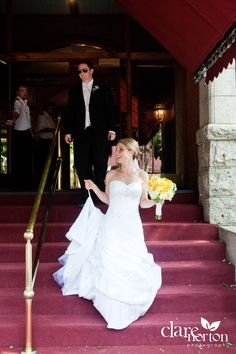 Bride and groom descend the elegant steps of the historic Portland Regency Hotel & Spa in Maine.