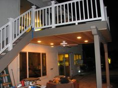 Simple Deck added ceiling, lights, Trex decking above, a T&G ceiling, and all new vinyl rails...All none to very little maintenance...