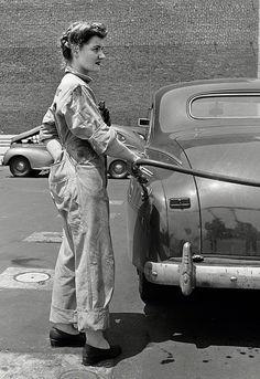 A woman pumps gas, June 1943.