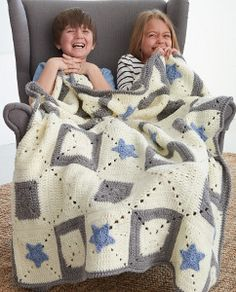 If you like star-gazing, you'll like it even more with this Crochet Star Crossing blanket. This free crochet pattern uses the treble crochet and half double crochet stitches.  | AllFreeCrochetAfghanPatterns.com
