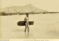 """1890 -This is the first known photograph ever taken of a surfer. Surfing was banned in Hawaii by missionaries in the 1700s for its """"ungodliness,"""" but fortunately the natives didn't pay much heed to that decree."""