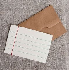 Notecard, envelope from paper lunch sack.
