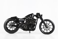 "Rough Crafts has just lifted the trophy in the 2013 AMD World Championship ""Modified Harley"" class for the Sportster-based ""Stealth Bullet"", which features a carbon gas tank and an oil-in-frame conversion."