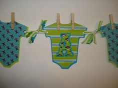 Aqua, Lime Green, & Gray Sock Monkey Banner, It's A Boy, Baby Shower Banner. $25.00, via Etsy.
