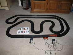 An uncropped picture of the Tomy slot car track layout that my nephew Josh and I put together at his home during my vacation.  This layout was designed by my son Brendan back in 1999 using the design software Tracker 2000.  He was 14 at the time.