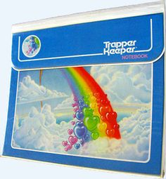 Trapper Keeper!  I can hear the Velcro ripping now:) Mine had a unicorn on it.