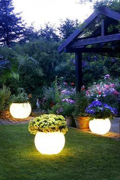 Glow in the dark paint on flower pots. (Rustoleum)
