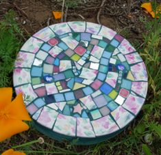 Mosaic Stepping Stone --  for the muddy walk from the driveway to the back door :) Perhaps even along the side of the house in front of the vertical gardens >:D