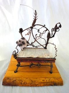 Just by looking at this you could probably whip down a pattern, pretty easily. Fairy furniture - the fairies' loveseat. 100.00, via Etsy.