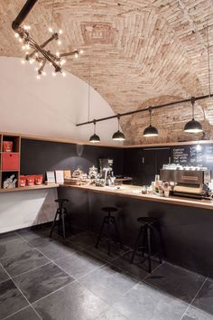 Budapest cafe with vaulted brick ceilings by Spora Architects