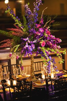 purple and green centerpiece, photo by Nikki Moore Photography http://ruffledblog.com/mardi-gras-wedding-inspiration #centerpieces #purple #weddingcenterpiece