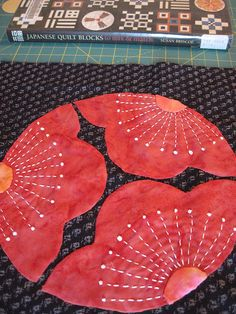 plum blossom, japanese quilts, a tattoo, quilt blocks, armchairs, hand quilting, mitsu ume, french knots, blossoms