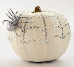 Use rhinestones and a metallic spray painted toy spider to recreate this glittery gourd!