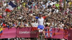 France's Julie Bresset won her country's 10th gold medal of the London 2012 Olympics after sealing victory in the women's mountain biking.