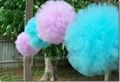 purple and blue tulle pom poms. this might work for a rainbow theme party.