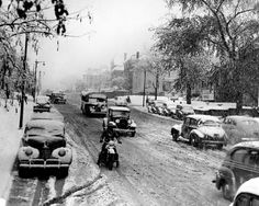 Traffic crept along on Oct. 31, 1941, after a layer of snow fell. This view is looking west from the intersection of Dodge Street and Turner Boulevard. THE WORLD-HERALD