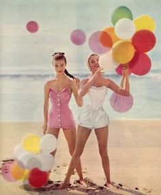 Models in beachwear with balloons,1950s.