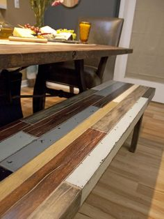 Anne and Jeribai's dining bench made was from reclaimed wood sits aside a farm-style dining table . If you're inspired, repin it! #hgtvstar