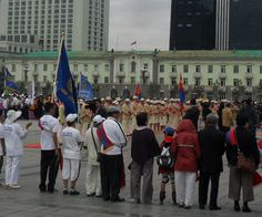 The Mongolian Olympic team (in cream uniforms) and spectators on Sukhbaatar Square. #London2012 london olymp, mongolian olymp, olymp 2012, olymp team