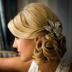 Low soft bun with hair clip bridesmaids, bun hairstyles, bridal hairstyles, wedding hairstyles, updo, flower, modern hairstyles, bridesmaid hairstyles, chignon