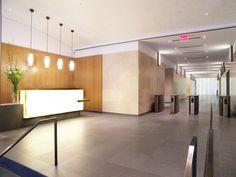 Anigre wood paneling. Backlit white onyx reception desk. Gertler & Wente. 125 Park Avenue. The Pershing Square Building. lobbi display, reception desks, recept desk
