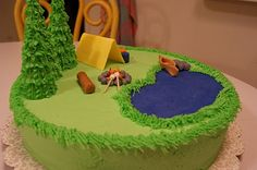 Camping cake with lake, tent, and campfire.  Perfect for blue and gold banquet.