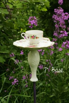 Vases, china teacups and sauces and a pole become a vintage garden theme bird feeder; repurpose, recycle, upcycle, salvage, diy!  For ideas and goods shop at Estate ReSale & ReDesign, Bonita Springs, FL