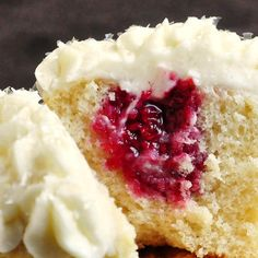 Raspberry Vanilla Cream Cheese Cupcakes - moist tender vanilla cupcakes filled with a delicious raspberry compote and topped with luscious cream cheese frosting.