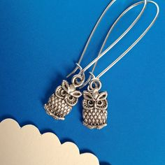 $7.00.  WISE OLD OWLS earrings.  Very cute.