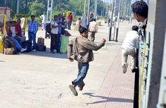 Indian guys running to catch the train after the Police left the wagons. Only one of them makes it to get on without the ticket.