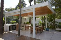 Covered terrace in The Morumbi Residence by Drucker Arquitetura