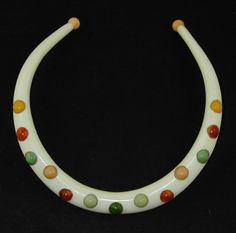 Multi Dot Necklace .  Authentic Bakelite Jewelry designed by Jorge Caicedo Montes de Oca . NY.NY.    Ivory color comb with multi color dots .