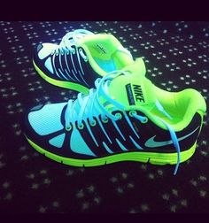 Blue, green, and black Nike shoes