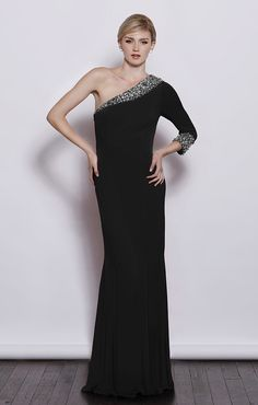 A stunning full length gown, features a one shoulder sleeve with embellished detailing.