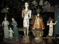 Various Santos    Spotted at an antique shop in Metro Manila. by Leo Cloma..many more pics here of various saints ans statues
