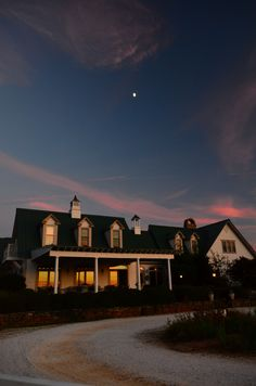 A beautiful sunset with the moon over the Main Inn. The sunsets here are amazing! See for yourself! www.theredhorseinn.com