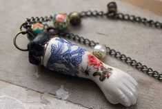 Antique Porcelain Tattooed Doll Arm Necklace