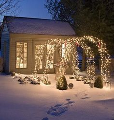 Imagine greeting your guests this season with a tunnel of arches enchanted with string upon string of brilliant white lights. Dramatic yet warm and welcoming, these arches do double duty when in spring you add climbing roses or other flowering vines right over the lights.