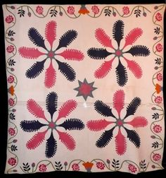 Here is another princess feather quilt - we don't often see pink and navy princess feathers.  Notice the orange flower in the center of each side border.  What was in her mind when the quilt maker chose that color?  -- From Sue Garmin's  blog