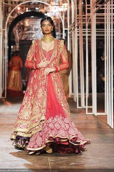 A model flaunts a creation by designer Tarun Tahiliani during the Grand Finale of the India Bridal Fashion Week (IBFW) 2013, held in New Delhi.