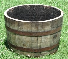http://barrelwholesalers.com/PlanterBarrels.aspx  Half Bourbon Barrels  Our half bourbon barrels are the most premium planters on the market. All rings are reinforced with staples, are swelled tight and are charred on the inside.      Min Order:  March-May= 1 Pallet (21 or 24 planters)  June-February = 1 truckload (546 planters)     FOB = Louisville, KY