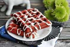 Red Velvet Waffles With Cream Cheese Glaze. Could make these for Valentine's day or top with green sprinkles for a Christmas breakfast.