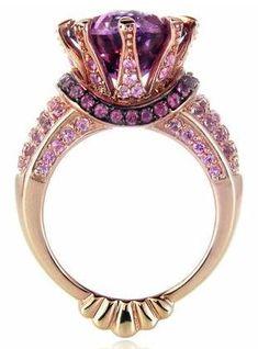 Rose gold, amethyst and black rhodium ring.