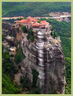 Meteora, Greece. Take the train from Athens and spend a day visiting the monasteries :)