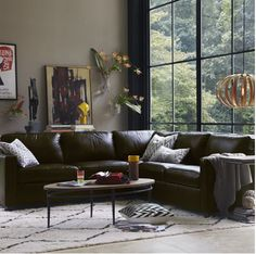 Brown leather with white rug. West Elm.