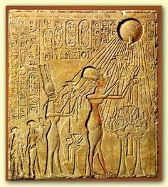 Pharaoh Akhenaten (center) and his family adoring the Aten, with characteristic rays seen emanating from the solar disk. The next figure leftmost is Meritaten, the daughter of Akhenaten, adorned in a double- feather crown
