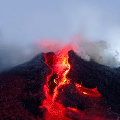 These photographs that appear to capture red-hot cracks in the Earth's surface weren't taken in Hawaii or Indonesia, but rather in the studio of artist Eszter Burghardt who uses wool and colored lights to create miniature natural landscapes including volcanoes, glaciers, fjords and rivers. See many more of her Wooly Sagas and a similar project using food: Edible Vistas. (via sinatra blue)