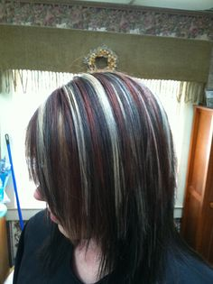 Dark hair with red lowlights and highlights with choppy layers